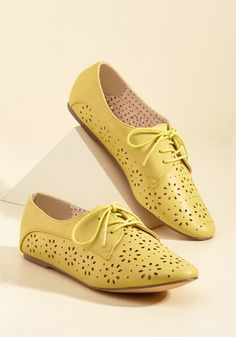 <p>Whether your outfit is floral-focused or building on basics, it could always benefit from the swift addition of these bright yellow flats! A fun and feminine offering from B.A.I.T. Footwear with their floral-shaped cutouts and classic derby silhouette, these faux-leather beauties are a fresh finishing touch.</p>