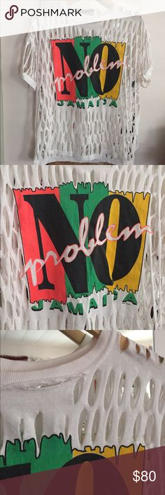 Vintage No Problem Jamaica Tee from the 80's Vintage No Problem Jamaica Tee from the 80's. no size on tag fits up to large comfortable. cute oversized vintage tee for festivals. rips and tears on purpose. jamaica, reggae, festival, unique, one of a kind Tops Tees - Short Sleeve