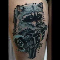 Raccoon camera tattoo