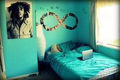 Small Room Decor Ideas for Blue Teenage Bedroom Design with Modern Bed Furniture that have Blue Bedding and Beautiful Bob Marley Picture Wall Accessories also Simple Window Types that have White Curtains