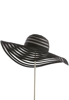 bef83120 Block out the sun in style with this mesmerizing floppy hat, featuring a  ribbed and