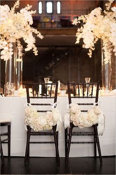 Image result for chairs wedding decoration with black chairs