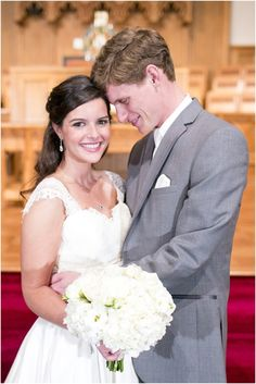 Dallas wedding photographer, Mary Fields Photography, capped sleeve wedding dress, white bridal bouquet, gray groom tux, indoor church wedding ceremony, bride and groom pictures
