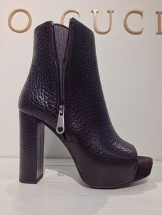 Open toe textured leather platform bootie from Brunello Cucinelli.