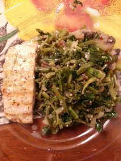 Grilled Lemon Pepper Salmon topped with butter, olive oil dill sauce and Spicy Kale with sauteed onions,  mushrooms, and green beans. Soooo great after a workout!!!!