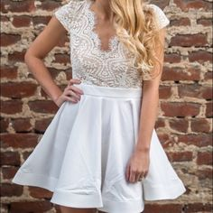 Short, White formal dress Lace top with keyhole back, and flowy skirt on bottom Dresses Mini