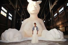 "Hilton Als on Kara Walker's mammy-as-sphinx sugar sculpture at the old Domino factory: ""Walker has made this servant monumental not only because she wants us to see her but so the sphinx can show us—so she can get in our face with her brown sugar underneath all that whiteness."""