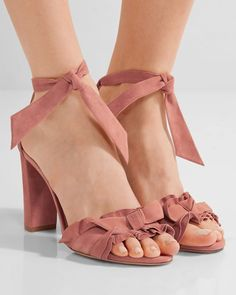 Alexandre Birman's velvety suede 'Lupita' sandals are a pretty antique-rose hue. Hand-finished with pretty ruffles, this pair is set on a sturdy block heel and secured with the label's bow tie fastenings. Wear yours with