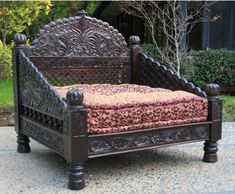 The Jhula's triple Arched back is shaped after the swings from the Maharaja's court, and hand carved from solid Indian Neem Wood, of the Mahogany family.  #Seats  #CarvedJhullaSeat #DayBeds