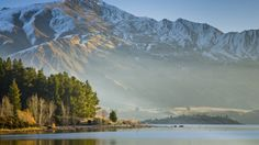 An ice covered mountain overlooking Lake Wanaka. Wanaka New Zealand, Wilderness Trail, Craters Of The Moon, Lake Wanaka, Bay Of Islands, South Island, Natural Wonders, National Parks, Explore