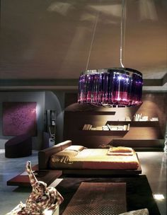 Glass prism lights are most often made in clear glass, but this one can be made in purple glass as well. Lovely. http://www.italian-lighting-centre.co.uk/glass-prism-lighting/italamp-tried-modern-clear-violet-glass-prism-pendant-p-7976.html#.VSeK0fnF9j8