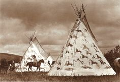 dakota sioux:  one bull's teepee on left and hunkpapa chief, old bull's on the right.  Both teepees depict coups counted during the famed Battle of Little Bighorn....25 june 1876.  by frank b fiske, fort yates, c 1890.