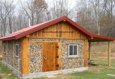 "This beautiful cordwood cabin, built by Gini & John Chandler, is going to be a custom bamboo fly-rod shop in eastern Ohio. The building is 19' x 27' with 16"" thick cordwood walls and they cut all the wood (including the cordwood) with their Wood-Mizer portable sawmill. They used yellow pine for the framework and the cordwood walls. The gable ends and inside ceiling are cedar and the door is made out of sassafras."