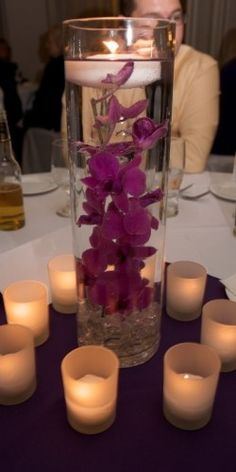 Elegant diy pearl and candle centerpieces 20 simple and chic candle centerpieces wedding centerpieces with candlesDiy Candle Centerpieces Wedding Reception Craft SElegant Diy Pearl And… Purple Wedding Centerpieces, Floating Candle Centerpieces, Vases, Wedding Decorations, Table Decorations, Centerpiece Ideas, Purple Centerpiece, Votive Candles, Submerged Centerpiece