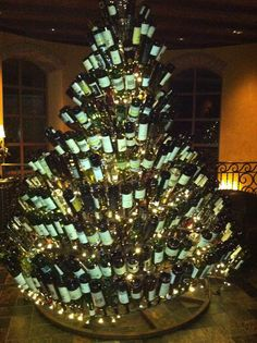 Christmas tree made entirely out of wine bottles!! This would be so cool to see at a winery or fancy restaurant.