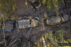 The infamous row of Volkswagen Beetles and other cars snailing through the woods.  The remote Swedish scrapyard where old cars rust in peace! Photographed with a drone. https://airbuzz.one/drone-pictures-of-bastnas-car-cemetery/ #dronephoto #droneblogg #djiblogg #djimavicpro #dji #carcemetery #sweden #carwrecks #oldcars #rustycars #cars #sweden #bilskroten #båstnäs #dronephotography #beetles #volkswagen #dieselpunk