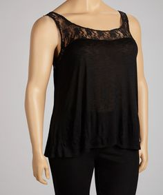 This lacy black tank is a timeless wardrobe addition that's perfect for achieving the ideal layered ensemble or sporting alone with jeans or slacks. Size note: This item runs small. Ordering one size up is recommended.