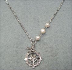 Bird Compass and White Pearl Necklace by turquoisecity on Etsy