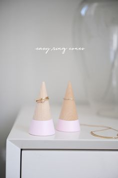 I have a friend who constantly forgets to wear her engagement and wedding rings. She takes them off to wash dishes, to shower, and before going bed. Because she doesn't wear much jewelry, she often leaves home without them, only to realize they're missing hours later. I decided to make her ring cones to keep next to the kitchen sink and on her nightstand, as a simple and pretty reminder to put them back on. Order wooden cones here. Tape around the cone and don't worry about it being per...