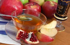 Rosh Hashanah meals usually include apples and honey, to symbolize a sweet new year.Pomegranates are used in many traditions, to symbolize being fruitful like the pomegranate with its many seeds.Typically, round challah bread is served, to symbolize the cycle of the year.