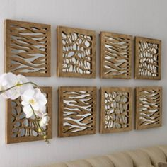 cut wood into designs & then put a mirror behind it.  pretty.