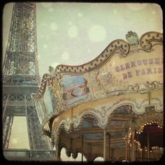 """An """"old"""" but still functioning carousel by the Eiffel Tower"""