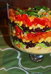 Seven-Layer Salad: sub quinoa for corn, and leave out the cheese. Perfect to bring to house parties.
