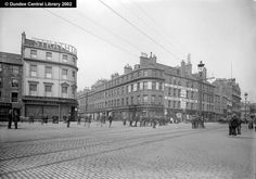 High Street, Dundee - This photograph shows the north side of Dundee High Street at the junction with Reform Street.  Strathtay House dominates the western corner, while on the opposite side stands H & W Tulloch, the London Hat Warehouse, above whose shop are the offices of the Life Association of Scotland.