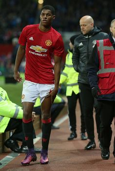 Marcus Rashford of Manchester United holds his leg after being substituted during the EFL Cup Fourth Round match between Manchester United and...