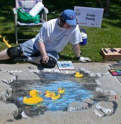 Ducks chalk pavement art at the Idaho Statesman Chalk Art Festival.