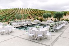 Stunning all white backyard wine country wedding reception at a private residence in Sonoma, California. Dream turned reality by Florist- Nancy Liu Chin Floral & Event Design, Planner- A Savvy Event and Photographer- The Edges Wedding Photography.