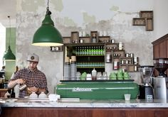 Little Henri - Melbourne. Really like the  use of a block colour for some key items (i.e. lighting, coffee machine, cups).  We think a dark forest green would work potentially work well for our aesthetic...