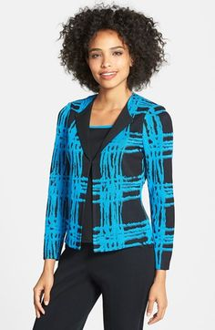 A vibrant, plaid-inspired jacquard contrasted with solid lapels sets apart a fitted jacket in an easy-care knit