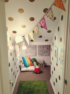 Cozy play corner under stairs