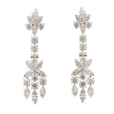 Glamorous Diamond Cluster Drop Earrings | From a unique collection of vintage chandelier earrings at http://www.1stdibs.com/jewelry/earrings/chandelier-earrings/