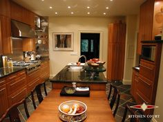 I like the rounded edges on the drawers.  Also the very pretty wood.  Kitchen & Bath designs contemporary kitchen cabinets