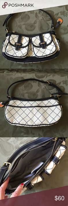 Dooney and Bourke shoulder bag Ivory cotton with black quilt stitching and ivory db's. Black leather trim and gold tone hardware. Two front pockets with loop closure. Small pockets on each side. Back has two slip pockets. Zip closure on main opening. Inside has small slip pocket and zip pocket. Only flaw is very small dirt mark that can come out with cleaning. No trades Dooney & Bourke Bags Shoulder Bags