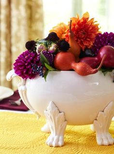 Fill a tureen with water-soaked florists' foam and a colorful combination of fall flowers and gourds. More Thanksgiving centerpieces: http://www.midwestliving.com/homes/seasonal-decorating/holiday-ideas/easy-thanksgiving-centerpieces/?page=8