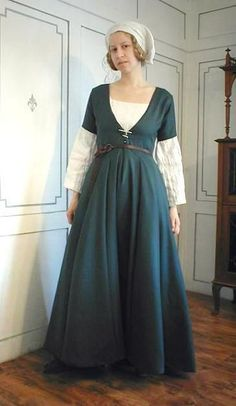 15th century German......as I am half Kraut and I like the V neck...this could be an achievable style for me ...Ya!!! Sewing...by hand...the ultimate challenge...actually cutting the pattern would be challenge enough lolz....HELP!!!!