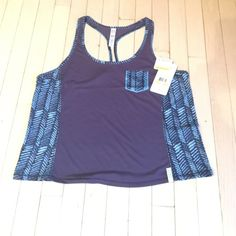 NWT Under Armour racer back tank NWT Under Armour racer back tank. Heat gear/running material  Shades of blue and purple with small pocket detail on front.  Size M Under Armour Tops Tank Tops
