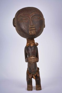 Ancient wooden doll figurine from the pygmy TIKAR people, Cameroon. This doll was used for luck. The wooden doll is nicely decorated with fabric and cauri shells. African Dolls, African Art, African Culture, Wooden Dolls, Tribal Art, Tag Art, Art And Architecture, Art For Sale, Metal Working