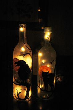 Halloween bottles lit up - one with black cat, one with crow.  Also available, witch on a broom stick, and owls.  $22 each plus shipping.  Please contact me if you're interested in purchasing.  Thanks!