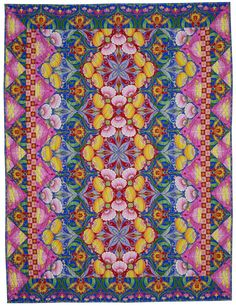 Oriental Carpet quilt by Jane Sassaman.  Fussy-cut blocks give the appearance of a kaleidoscope design.  National Quilt Museum exhibit 2017.
