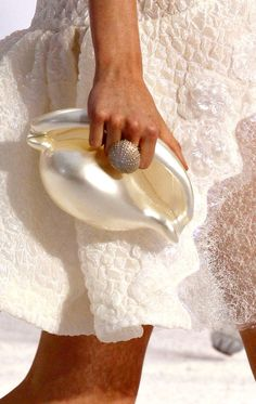 Chanel conch shell clutch. #celebstylewed #celebritystyleweddings.com