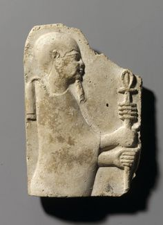 relief of Ptah Holding Ankh and Djed: Medium: Stucco Place Made: Egypt Dates: 4th-3rd century B.C.E. Period: Late Period-Ptolemaic Period