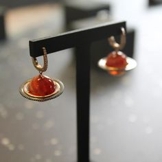 Dominic Jones' debut jewellery collection for Astley Clarke named Astronomy. Inspired by space, stars and planets. In a stylised fashion using colourful gemstones. http://www.thejewelleryeditor.com/jewellery/article/dominic-jones-astley-clarke-astronomy-jewellery-collection/ #jewelry