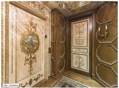 Elevator door trompe l'oeil painted with MM metallic paint, MM glaze. Walls faux finished with MM glaze into a stained wood look, and all details painted with MM gold metallic paint. Park Towers,Las Vegas   Modern Masters Photo Contest Entry by Adrian Ridgley   To Vote and Enter Please Click Link