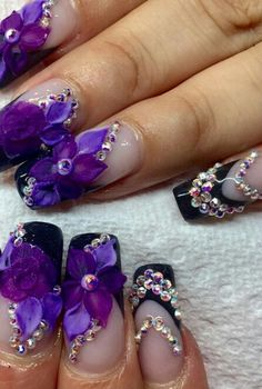 Purple floral rhinestone nails @nails_by_verovargas