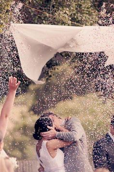 "''When the officiant says, ""kiss the bride"" the maid of honor and best man pull the string and petals fall!'' Cute idea!"