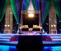 Google Image Result for http://maharani.wpengine.netdna-cdn.com/wp-content/uploads/2012/12/4-indian-wedding-green-blue-purple-reception.jpg